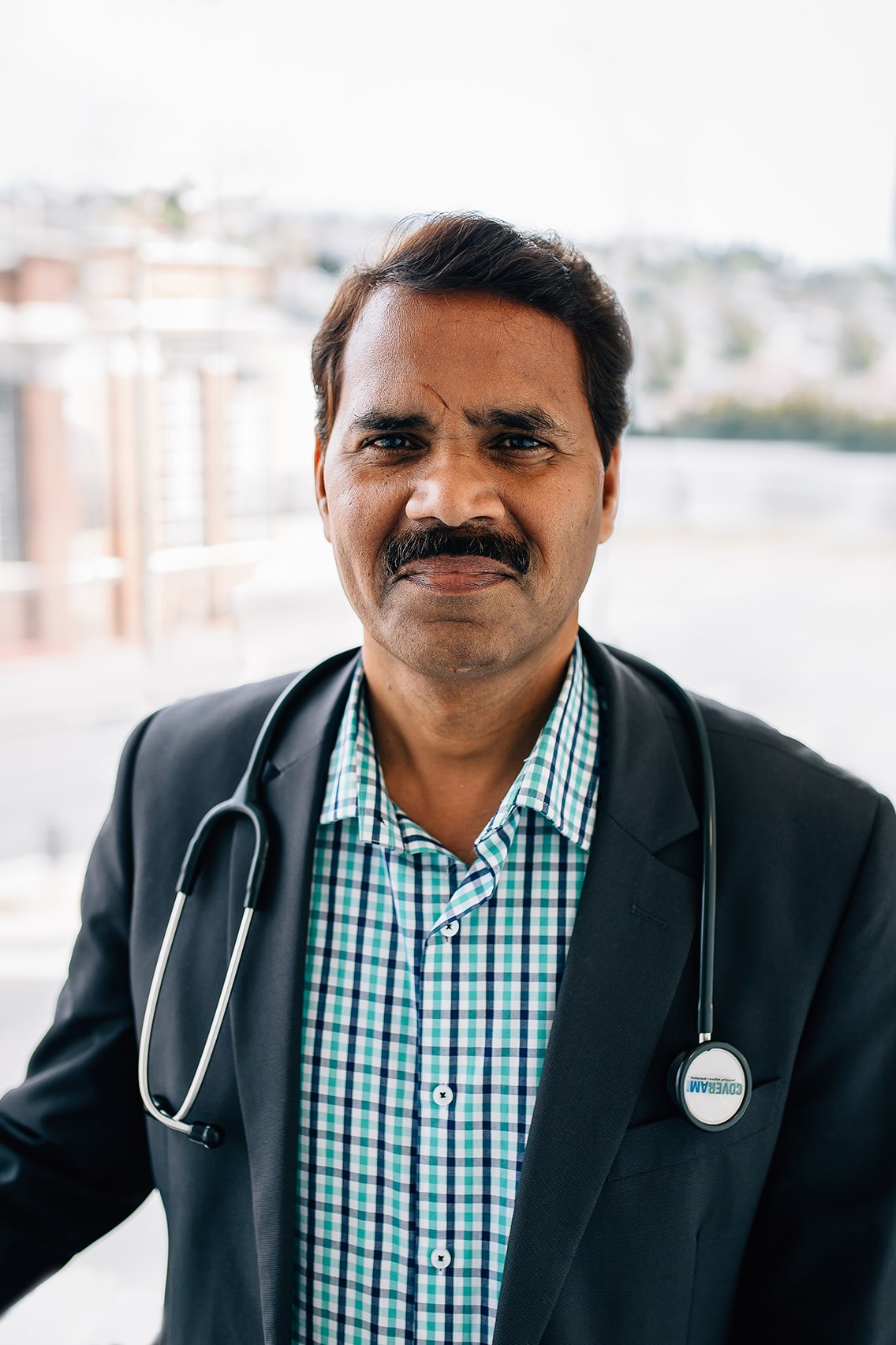 Dr. Suresh Sharma